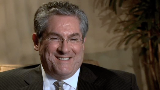 Dr. Justo smiling during an interview.